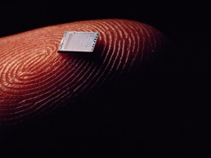 bruce-dale-extreme-close-up-of-a-microchip-on-a-fingertip