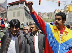 Venezuela's Vice President Maduro and Bolivian President Morales walk ahead of the vehicle carrying the coffin of Chavez in Caracas