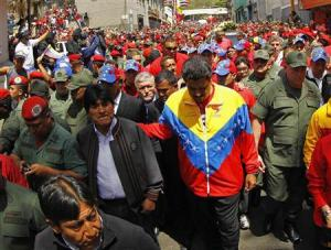 Venezuela's Vice President Maduro and Bolivian President Morales walk ahead of the vehicle carrying the coffin of deceased Venezuelan leader Chavez in Caracas
