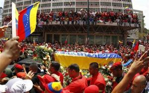 The coffin of deceased Venezuelan leader Chavez is driven through the streets of Caracas after leaving the military hospital where he died of cancer, in Caracas