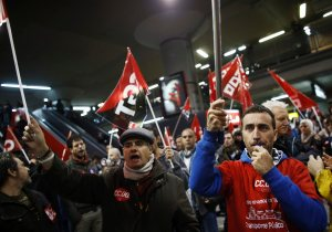 Picketers shout slogans at Atocha rail station during a 24-hour nationwide general strike in Madrid