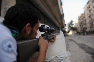 A fighter from the Syrian opposition aim