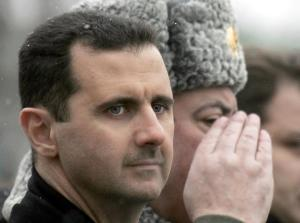Syrian President Bashar al-Assad inspect