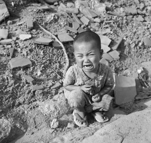 Japanese Toddler Crying Amongst Rubble