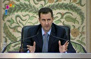 Syria's President Bashar al-Assad delivers a speech to a new cabinet he named last week, in Damascus