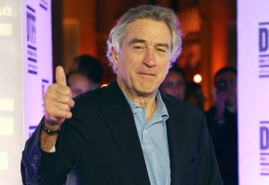 "File picture of actor Robert De Niro giving the thumbs-up as he arrives at the ""Stone"" film premiere during the 2010 Doha Tribeca Film Festival in Doha"