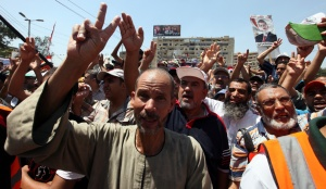 Supporters of the Muslim Brotherhood attend a protest in support of ousted Egyptian president Mohamed Morsi