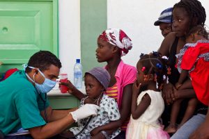A Cuban doctor treats children suffering from cholera at the hospital in L'Estere