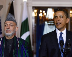 File photo shows U.S. President Obama speaking to the media with Afghan President Karzai at his side after their meeting in Washington