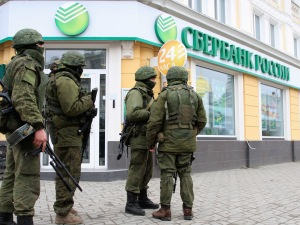 Armed men patrol in the center of the Crimean city of Simferopol