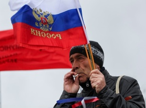 Participant holds a Russian flag during a pro-Russian rally in central Donetsk