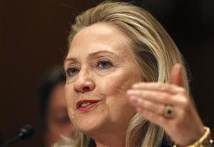 """Secretary of State Hillary Clinton gestures while testifying before the Senate Appropriations Committee about """"The FY2013 Budget Request for the Department of State and Foreign Operations"""" on Capitol Hill in Washington"""
