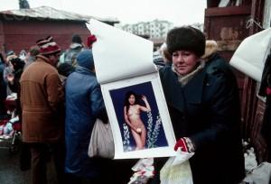 Woman Selling Nudie Calendar in Moscow Market