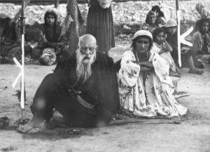 Be__ec_-__Gypsy_couple_sitting_in_an_open_area