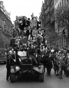 8th May 1945:  VE Day revellers hitching a ride on a lorry in London.  (Photo by Central Press/Getty Images)