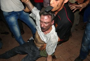 -- AFP PICTURES OF THE YEAR 2012 --  REFILING TO IDENTIFY VICTIM Libyan civilians help an unconscious man, identified by eyewitnesses as US ambassador to Libya Chris Stevens, at the US consulate compound in Benghazi in the early hours of September 12, 2012, following an overnight attack on the building. Stevens and three of his colleagues were killed in an attack on the US consulate in the eastern Libyan city by Islamists outraged over an amateur American-made Internet video mocking Islam, less than six months after being appointed to his post.  AFP PHOTO/STR
