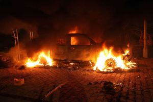 TOPSHOTS A vehicle and the surrounding area are engulfed in flames after it was set on fire inside the US consulate compound in Benghazi late on September 11, 2012. An armed mob protesting over a film they said offended Islam, attacked the US consulate in Benghazi and set fire to the building, killing one American, witnesses and officials said. AFP PHOTO