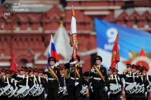 ITAR-TASS: MOSCOW, RUSSIA. MAY 9, 2013. Russian soldiers with flags marching during the Victory Day military parade in Red Square to commemorate the 68th anniversary of the Soviet Union's victory over Nazi Germany in 1945. (Photo ITAR-TASS/ Sergei Karpov) Ðîññèÿ. Ìîñêâà. 9 ìàÿ. Ó÷àñòíèêè âîåííîãî ïàðàäà íà Êðàñíîé ïëîùàäè, ïîñâÿùåííîãî 68-é ãîäîâùèíå ïîáåäû â Âåëèêîé Îòå÷åñòâåííîé âîéíå. Ôîòî ÈÒÀÐ-ÒÀÑÑ/ Ñåðãåé Êàðïîâ
