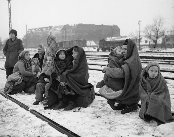 14th December 1945: Huddling in blankets the only survivors of an original 150 Polish people who walked from Lodz in Poland to Berlin hoping to find food and shelter. They are waiting by a railway track hoping to be picked up by a British army train and given help. (Photo by Fred Ramage/Keystone/Getty Images)