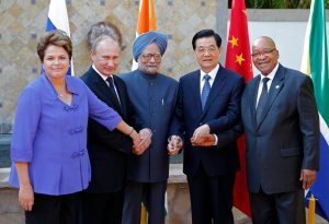 BRICS' heads of state, from left, Brazil's President Dilma Rousseff, Russia's President Vladimir Putin, India's Prime Minister Manmohan Singh, China's President Hu Jintao and South Africa's President Jacob Zuma pose for a group photo at the G-20 Summit in Los Cabos, Mexico, Monday, June 18, 2012. (AP Photo/Andres Leighton)