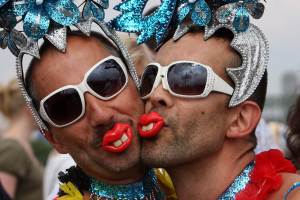 Participants of the Christopher Street Day (CSD) gay pride parade pose in Cologne, western Germany on July 4, 2010. Thousands of gays and lesbians marched through the streets of Cologne to demonstrate for equality and social acceptability.  AFP PHOTO / PATRIK STOLLARZ