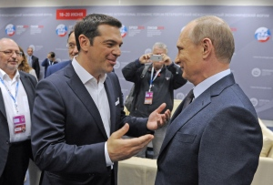 ST. PETERSBURG, RUSSIA. JUNE 19, 2015. Russia's President Vladimir Putin (R) and Prime Minister Alexis Tsipras of Greece talking ahead of a plenary session titled