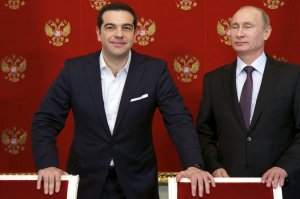 Russian President Vladimir Putin (R) and Greek Prime Minister Alexis Tsipras attend a signing ceremony at the Kremlin in Moscow, April 8, 2015. Greek Prime Minister Alexis Tsipras did not ask for financial aid at talks in Moscow on Wednesday but Russia could provide credits for large joint projects in the future, President Vladimir Putin said. REUTERS/Alexander Zemlianichenko/Pool