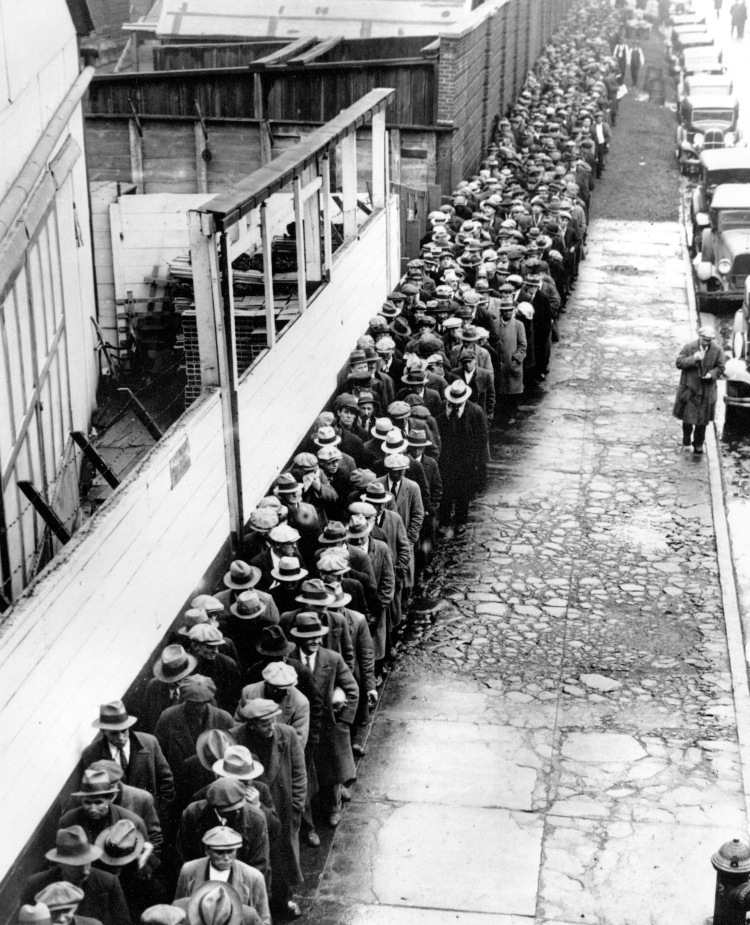 ** FILE ** In this 1932 file photo, long line of jobless and homeless men wait outside to get free dinner at New York's municipal lodging house during the Great Depression.  (AP File Photo)