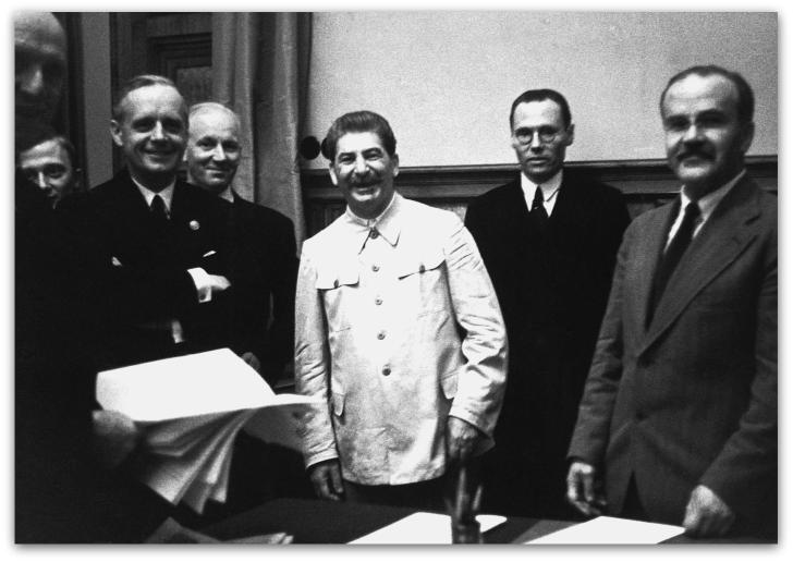 23 Aug 1939, Moscow, USSR --- Vyacheslav Molotov (right), foreign minister for the USSR and Joachim von Ribbentrop (left), foreign minister for Germany at the signing of the Soviet-German Non-Aggression Pact with Joseph Stalin (center). Moscow, USSR, August 23, 1939. --- Image by © CORBIS