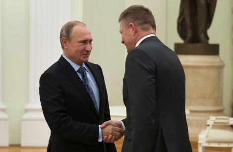 Russian President Vladimir Putin, left, and Slovak Prime Minister Robert Fico shake hands during their meeting in the Kremlin in Moscow, Russia, Tuesday, June 2, 2015. (AP Photo/Pavel Golovkin, Pool)