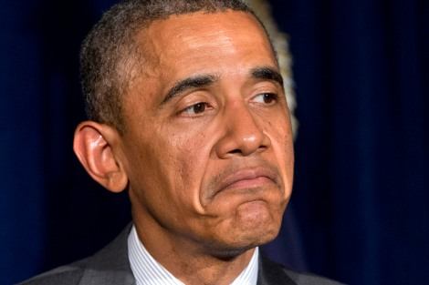 President Barack Obama pauses during a news conference after meeting with Gov. Rick Perry in Dallas about immigration on Wednesday, July 9, 2014. (AP Photo/Jacquelyn Martin)