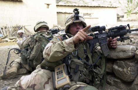 US Army (USA) Sergeant (SGT) Brandon Cross, 3-505th Infantry, armed with a 5.56mm M4 carbine, directs Soldiers to take up a defensive positions, as they arrive in the town of Gangikhel, located in Malikasay, Afghanistan, during a mission to seek out enemy forces and locate weapon cache's, during Operation ENDURING FREEDOM.