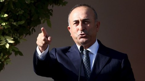 Turkey's Foreign Minister Mevlut Cavusoglu speaks to the media during a visit to northern Cyprus, November 26, 2015. REUTERS/Yiannis Kourtoglou - RTX1VYOF